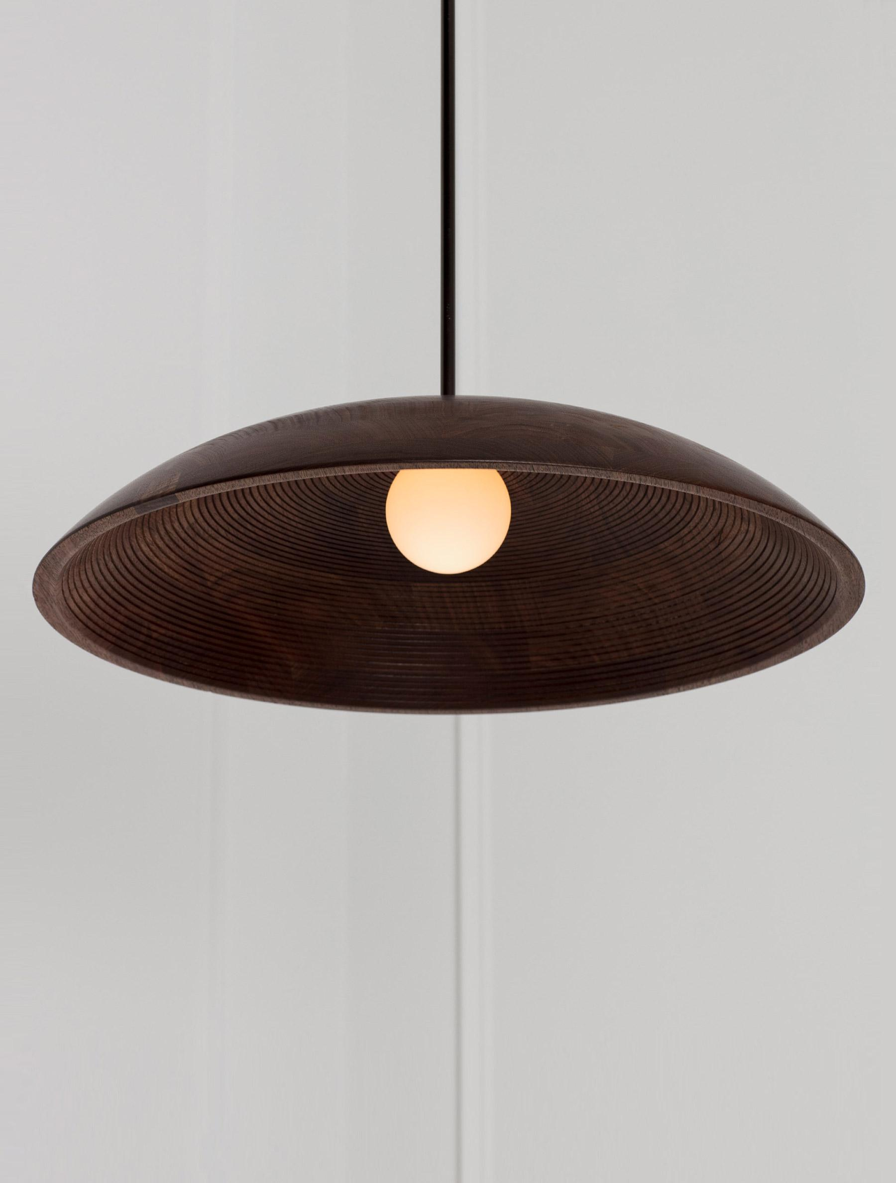 "Concentric Pendant 20"" shown in Blackened Brass, Black Walnut Dome, and Matte White Globe"