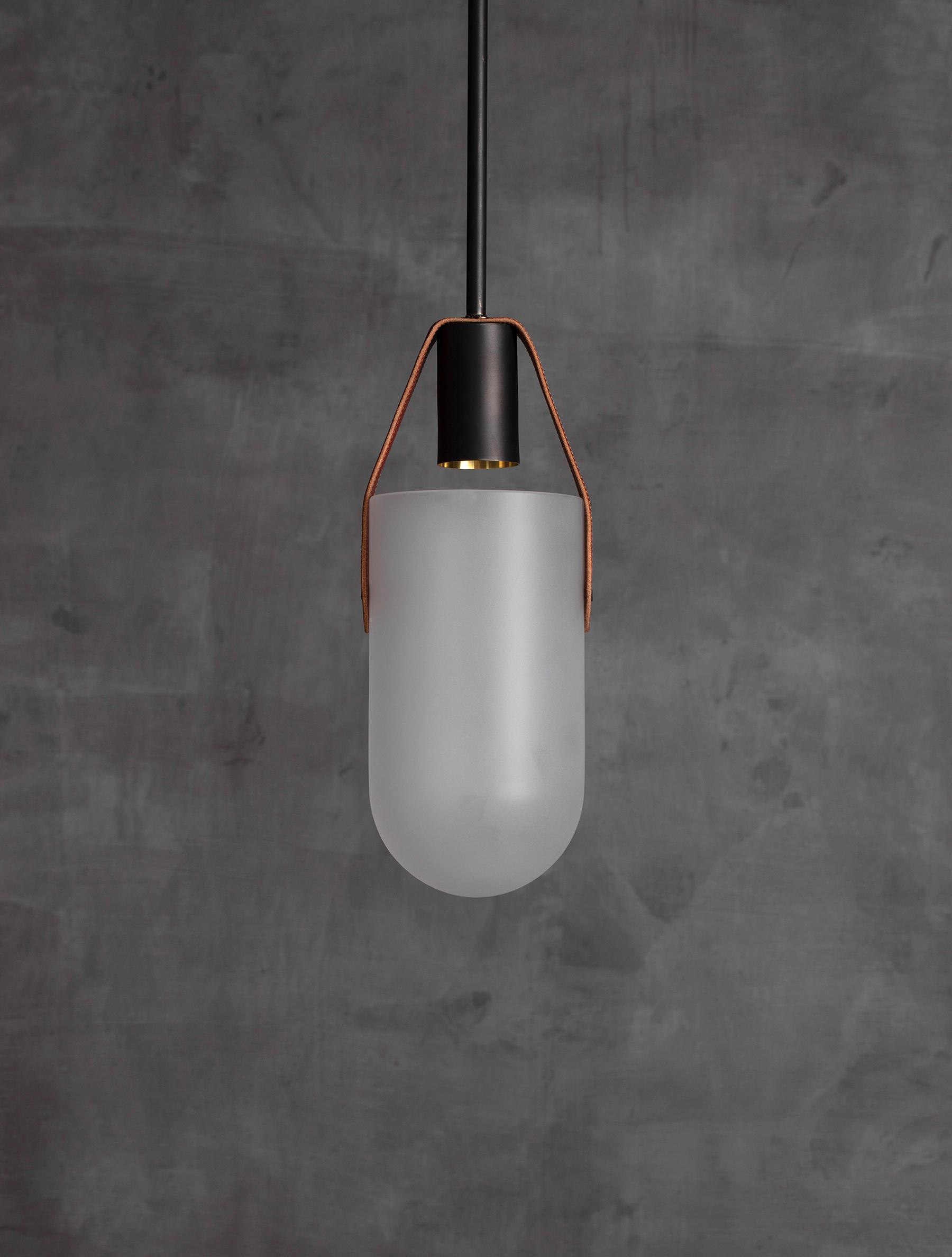 Well Pendant Mini shown in Flat Black, Tan Leather, Frosted Glass