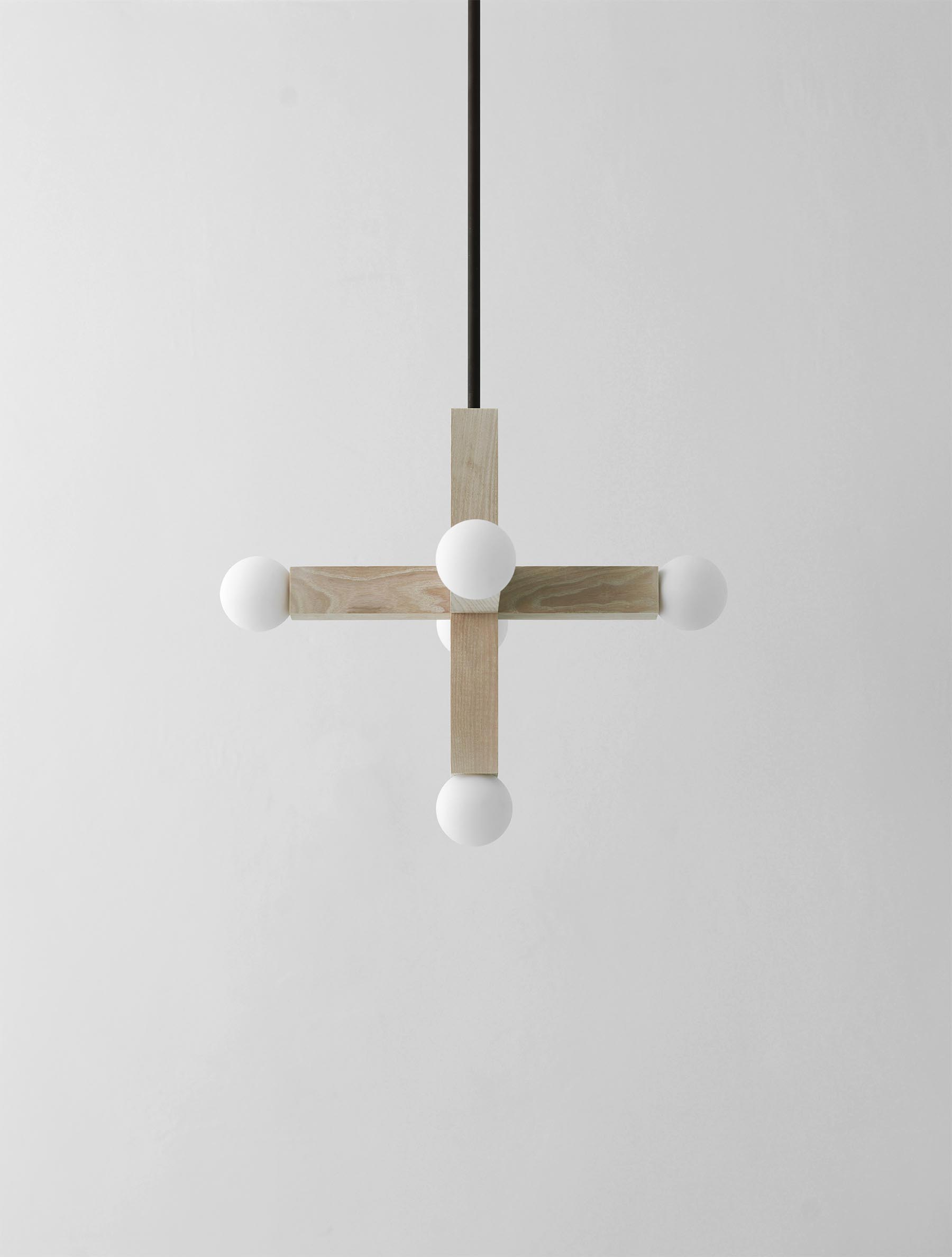 Union Pendant shown in Maker Black, Bleached Ash, Matte White Globes