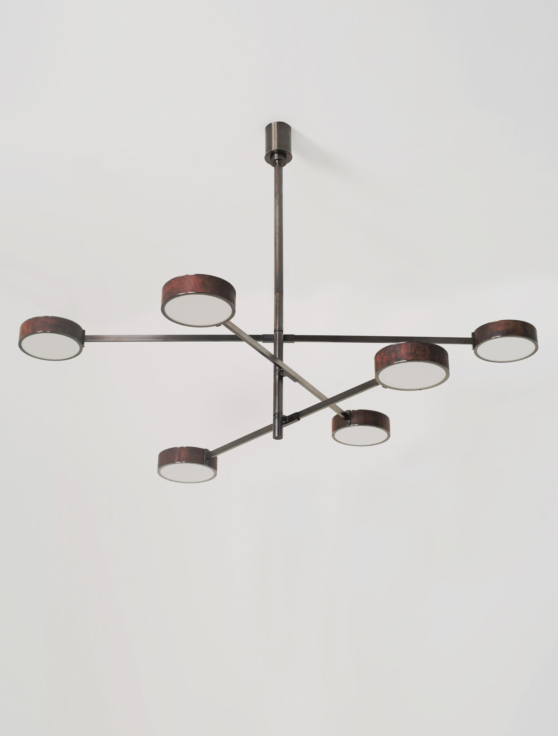 Monoscope 6 Chandelier shown in Blackened Brass, Walnut Burl