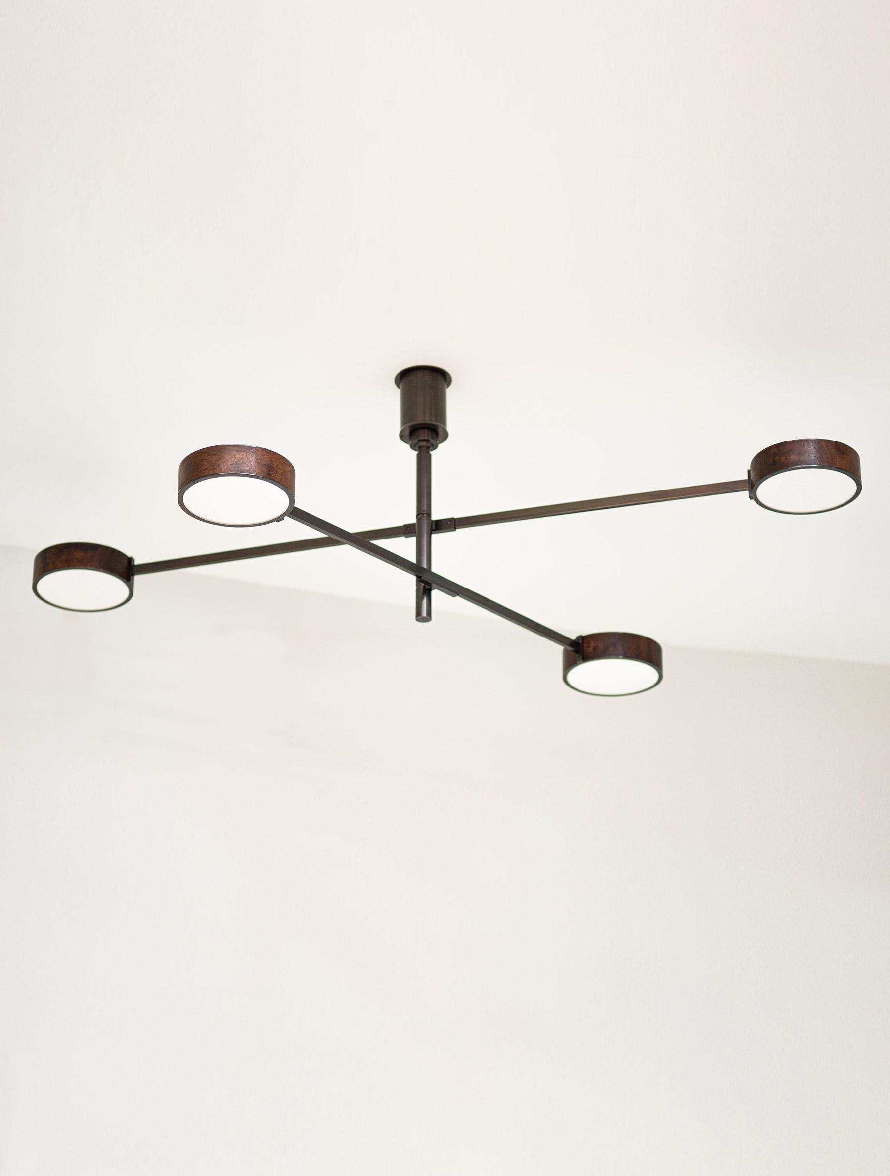 Monoscope 4 Chandelier shown in Blackened Brass, Walnut Burl
