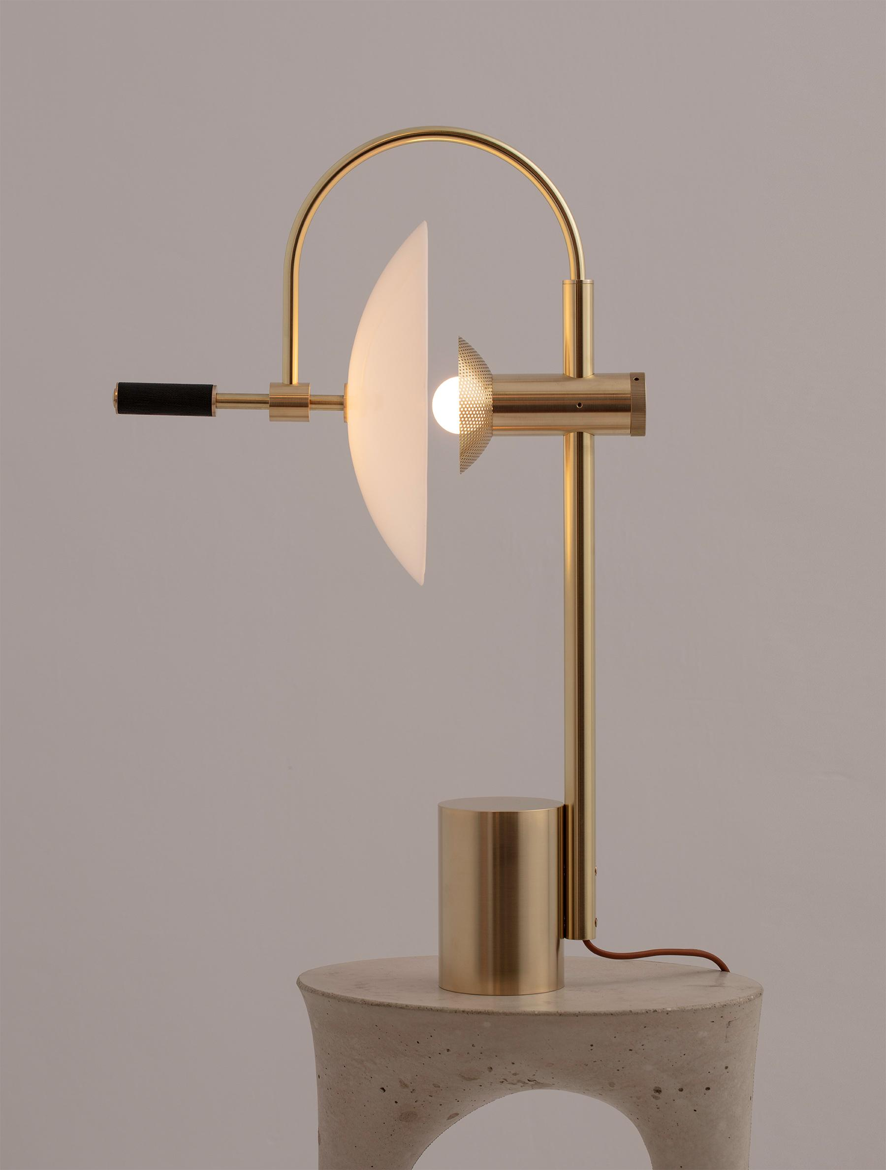 Aperture Table Lamp shown in Brass, Black Walnut, Opal Dome, Tan Leather
