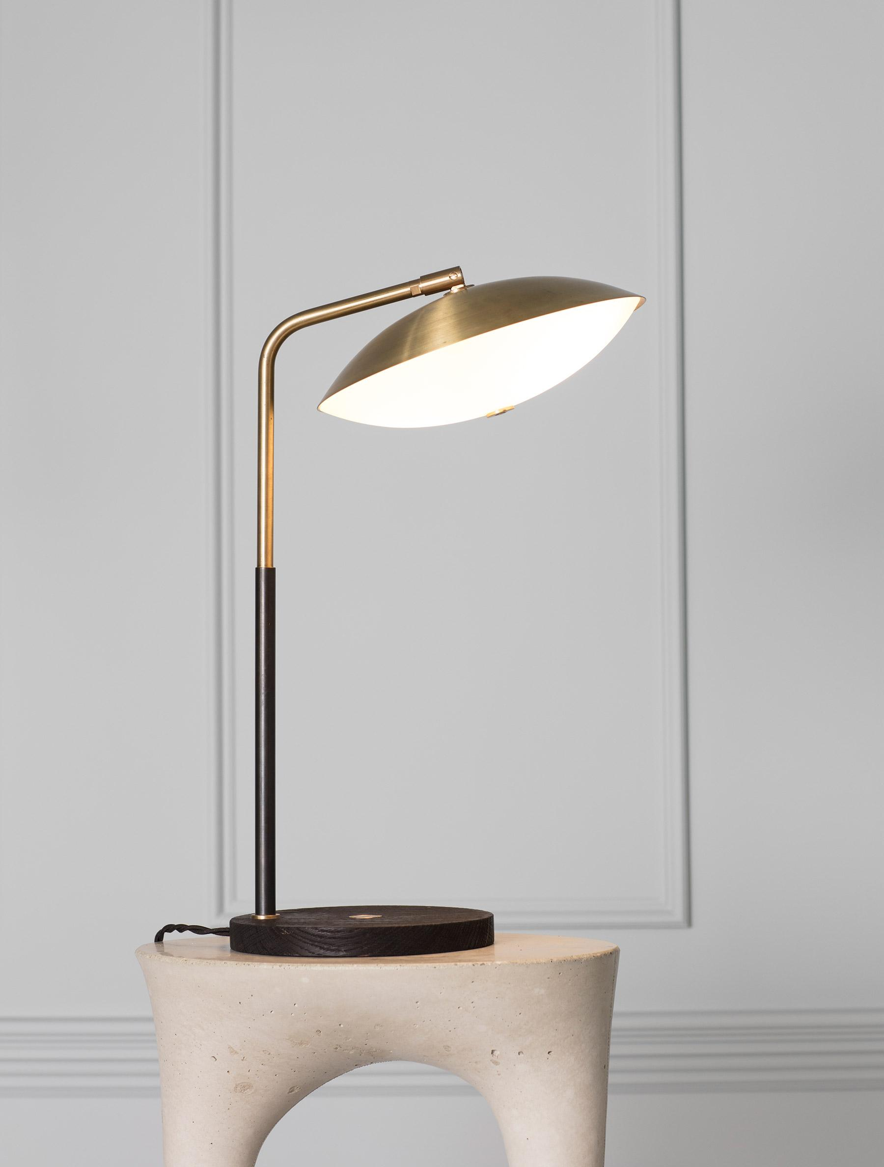 Crest Table Lamp shown in Brass, Blackened Brass, Flame Blackened Oak, and Opal Glass