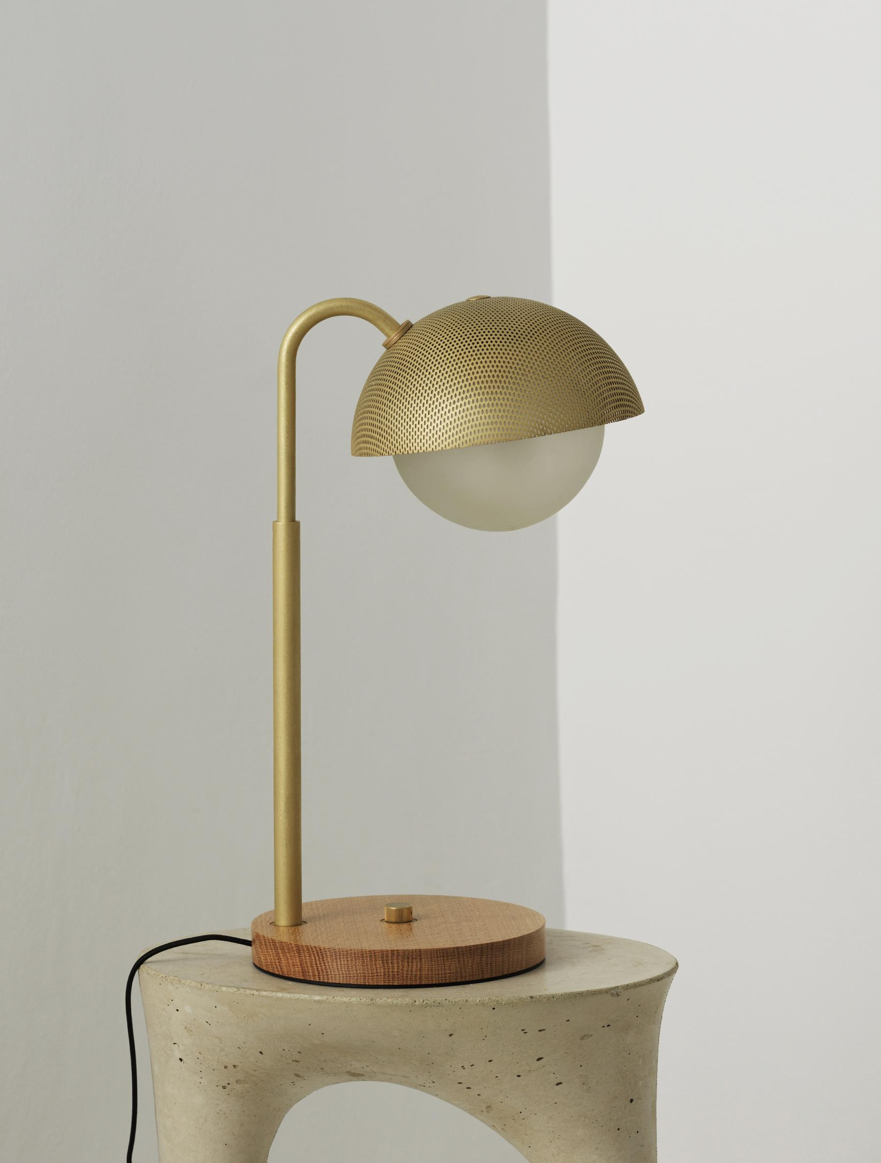 Dome Table Lamp Perforated shown in Stonewashed Brass, White Oak Base, Frosted Globe