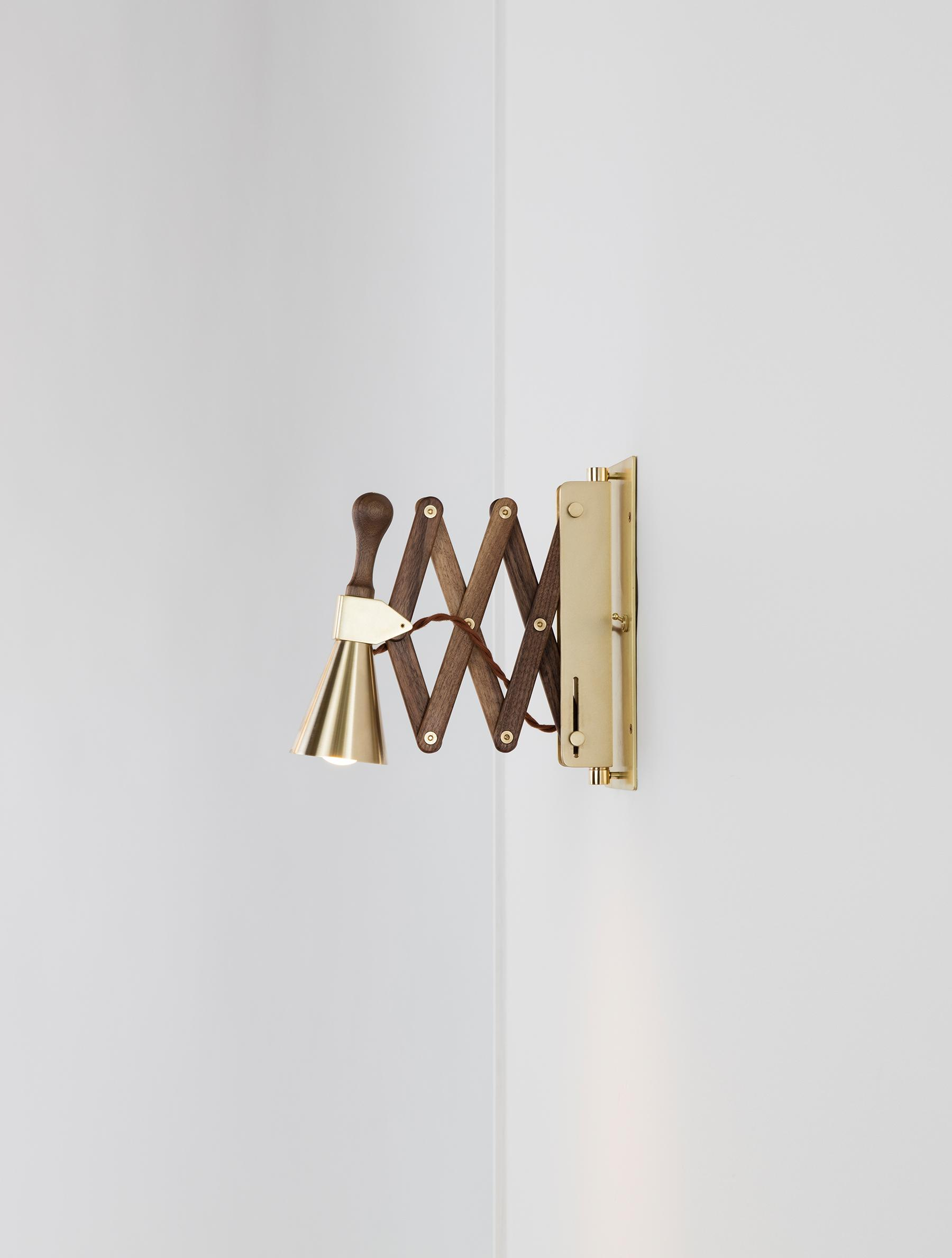 Accordion Bell Sconce shown in Brass, and Black Walnut