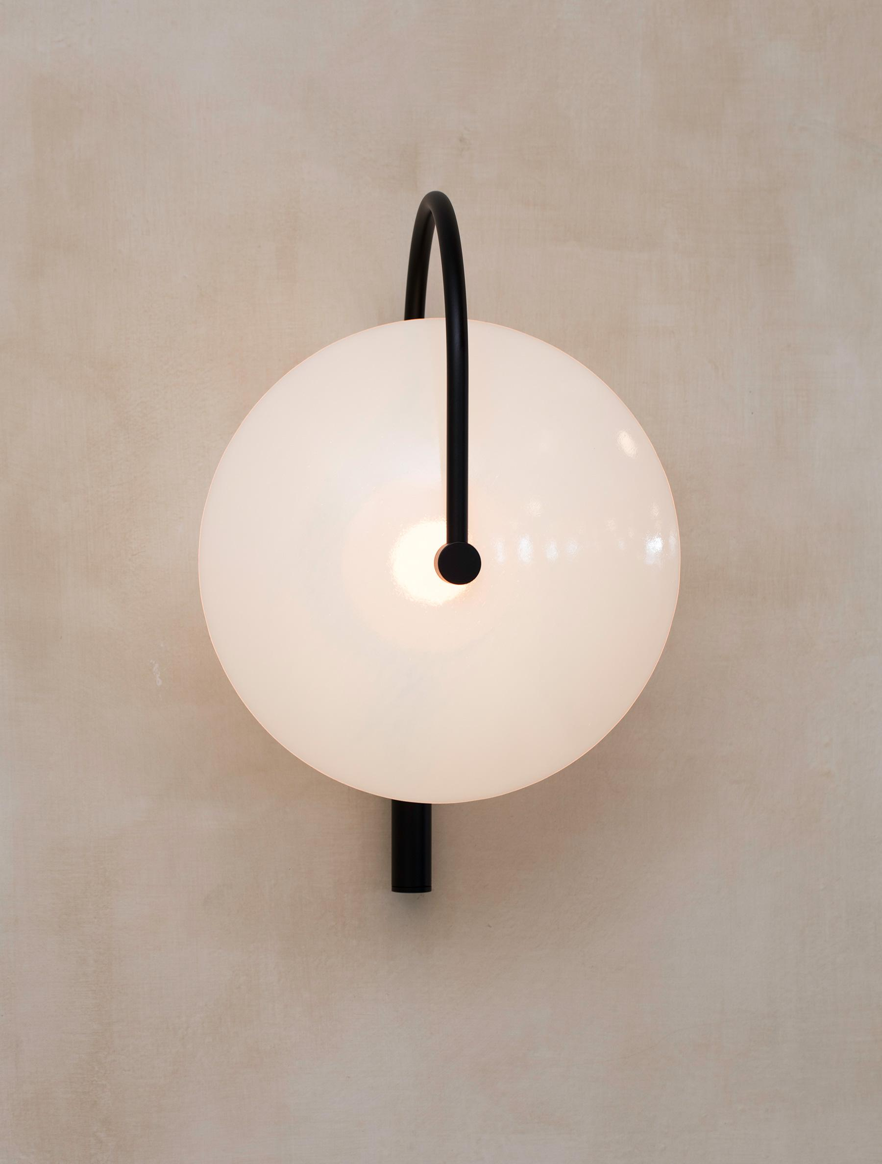 Aperture Sconce shown in Flat Black, Opal Dome