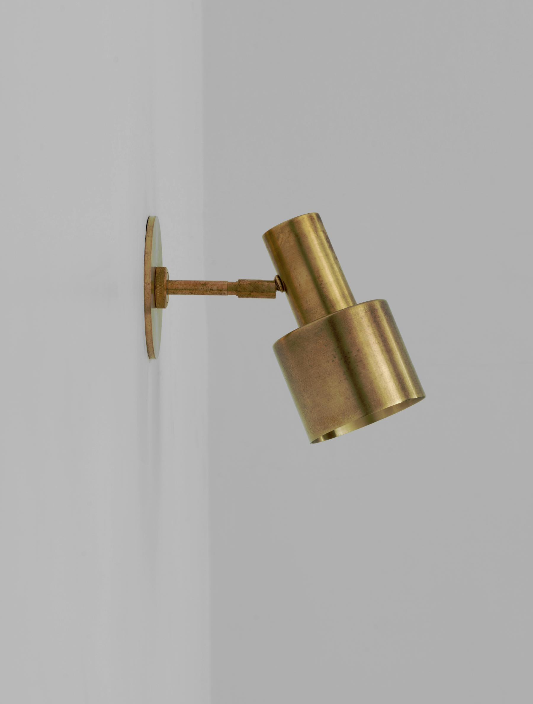 Composer Sconce shown in Raw Brass
