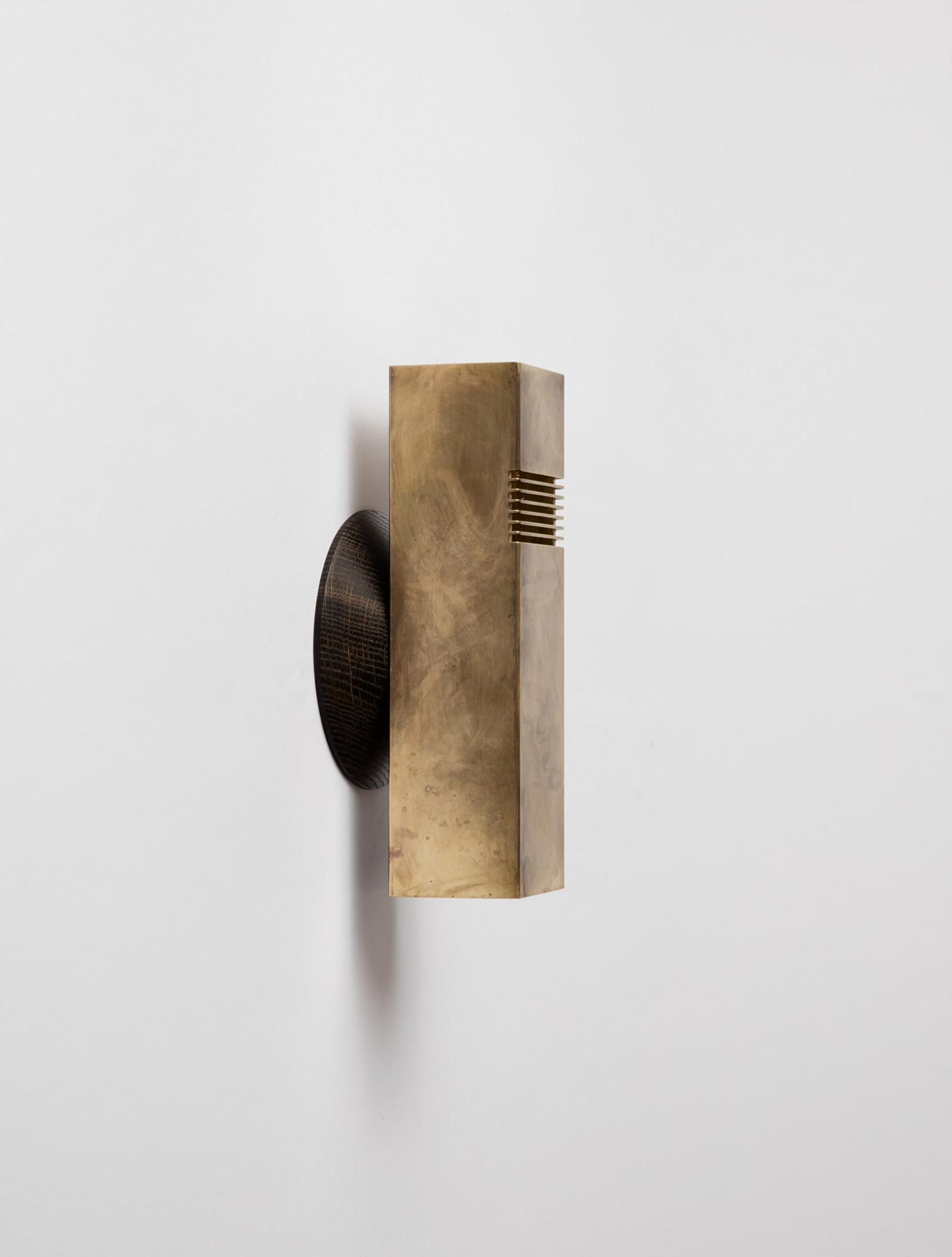 Groove Sconce shown in Raw Brass, Oxidized Oak