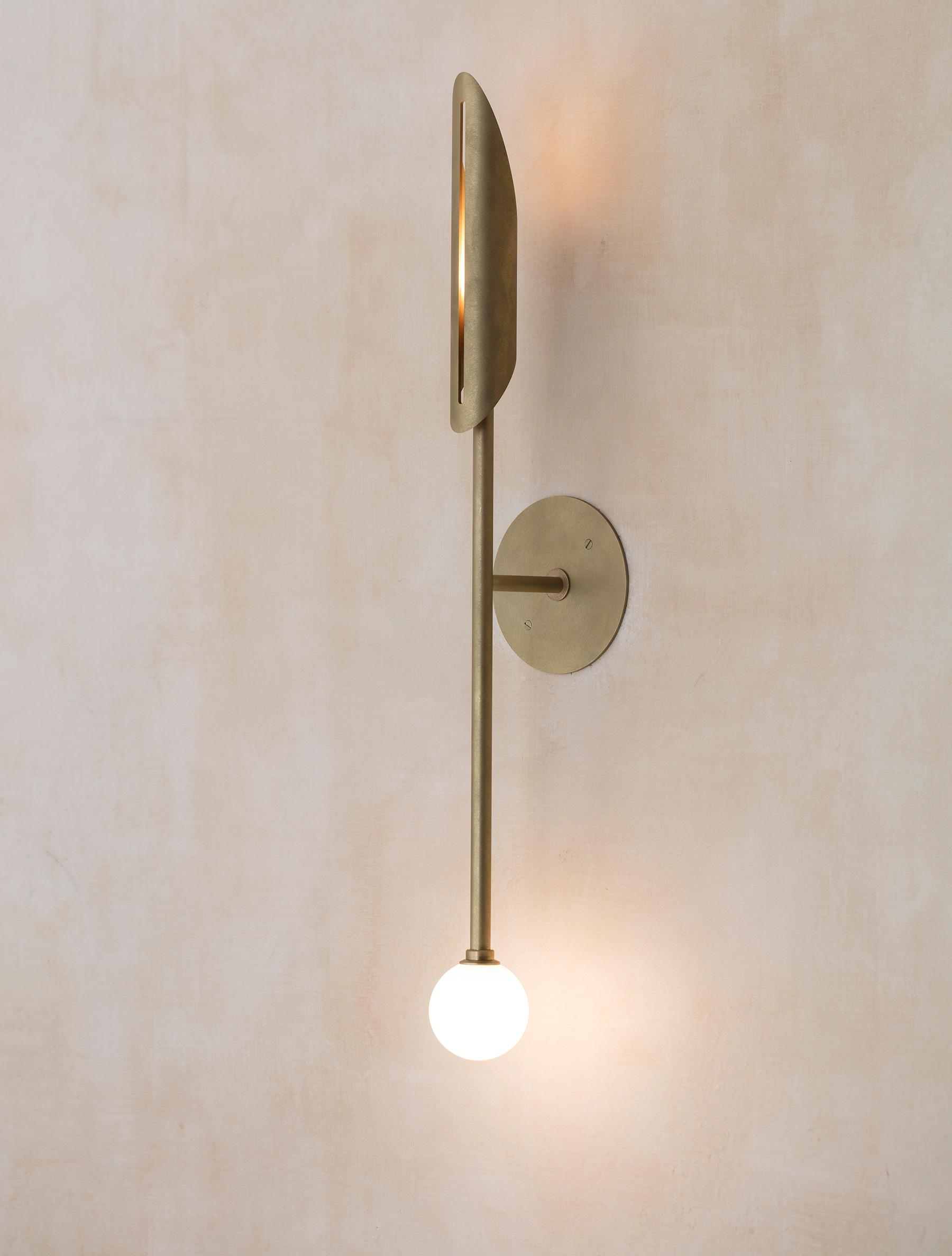 "Voyager 11"" Orb Sconce shown in Stonewashed Brass, Opal Globe"