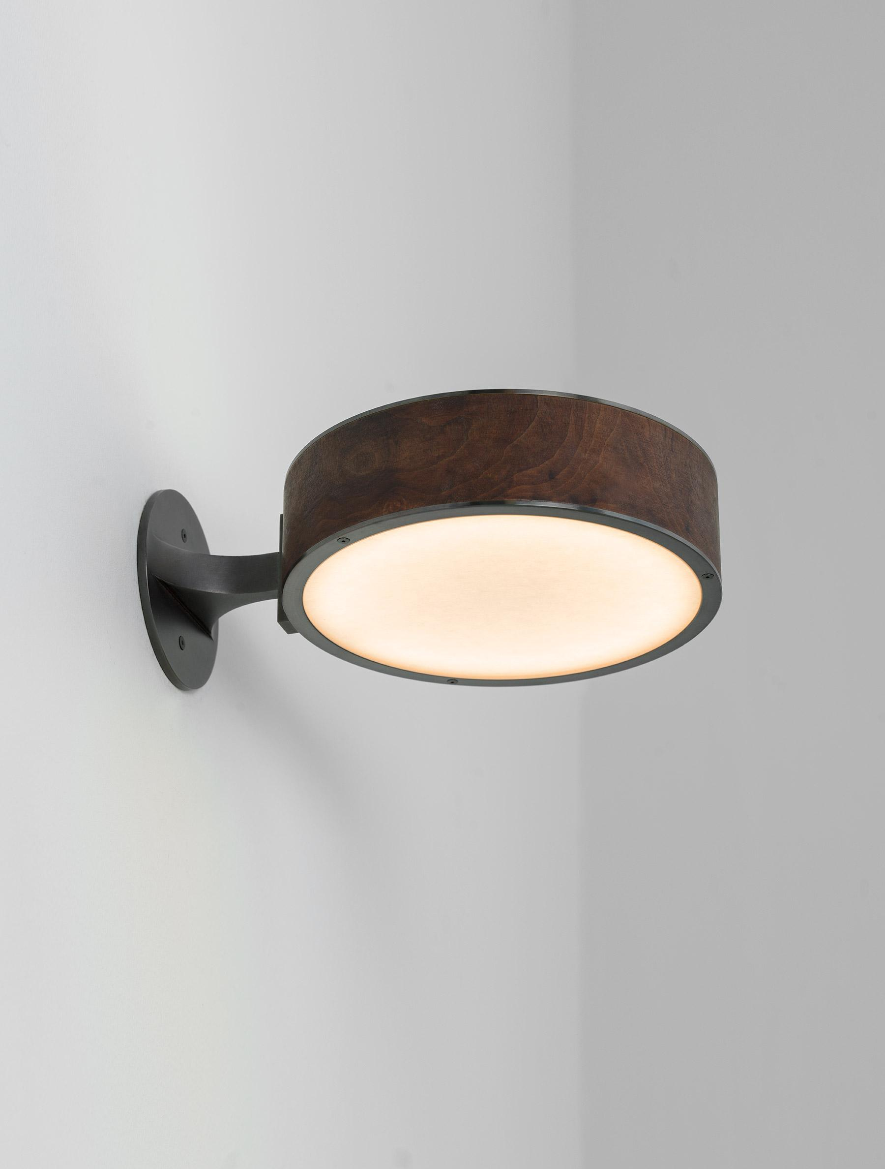 "Monoscope Sconce 10"" shown in Maker Black, Walnut Burl"